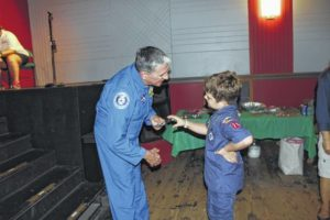 Thomas presents scouts with badges